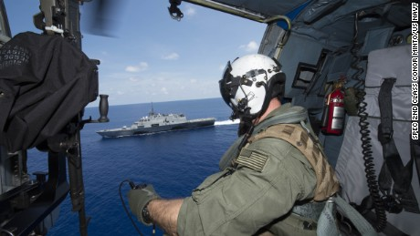 SOUTH CHINA SEA (May 12, 2015) Naval Aircrewman (Tactical Helicopter) 2nd Class Ian Carpenito, assigned to Helicopter Maritime Strike Squadron (HSM) 35, observes the littoral combat ship USS Fort Worth (LCS 3) as it conducts routine patrols in international waters. (U.S. Navy photo by Mass Communication Spec 2nd Class Conor Minto/Released)