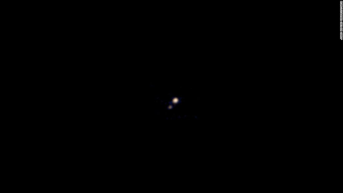 New Horizons used its color imager to capture this image of Pluto and Charon on April 9. This was the first color image taken by a spacecraft approaching Pluto and Charon, according to NASA. The spacecraft was about 71 million miles away from Pluto when the photo was taken.