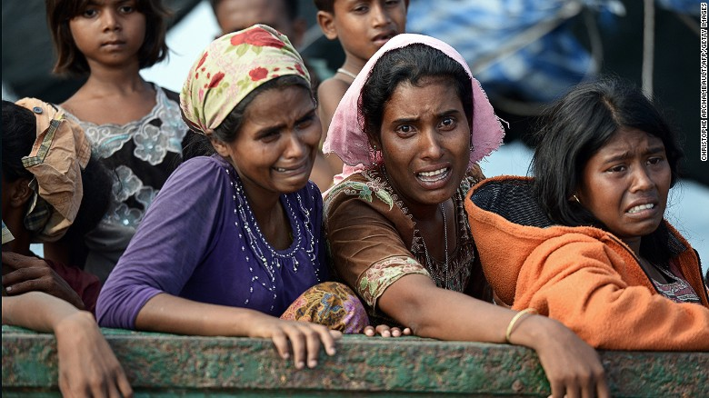 Rohingya migrant women cry as they sit on a boat drifting in Thai waters off the southern island of Koh Lipe in the Andaman sea on May 14, 2015.  The boat crammed with scores of Rohingya migrants -- including many young children -- was found drifting in Thai waters on May 14, according to an AFP reporter at the scene, with passengers saying several people had died over the last few days.