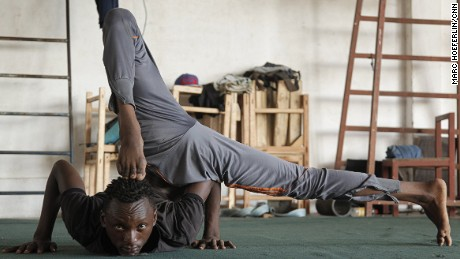 Tanzanian acrobat performers, the Hakuna Matata troupe, practice at their training facility in Dar es Salaam.