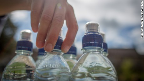 MIDSOMER NORTON, ENGLAND - MAY 12:  In this photo illustration a woman drinks bottled water on May 12, 2015 in Midsomer Norton, England. Water is set to be the world's best selling soft drink by health conscious consumers concerned about sugar and additives turning their backs on fizzy drinks.  (Photo by Matt Cardy/Getty Images)