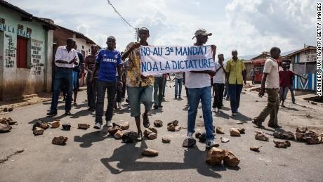 People demonstrate against Burundi President Pierre Nkurunziza's bid for the 3rd term in Nyakabiga neighborhood in Bujumbura on Saturday, May 16.