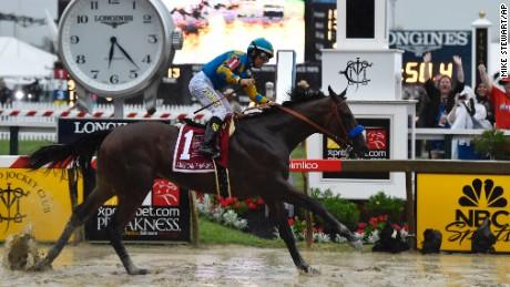 American Pharoah, ridden by Victor Espinoza, wins the 140th Preakness Stakes  at Pimlico Race Course, Saturday, May 16 in Baltimore.