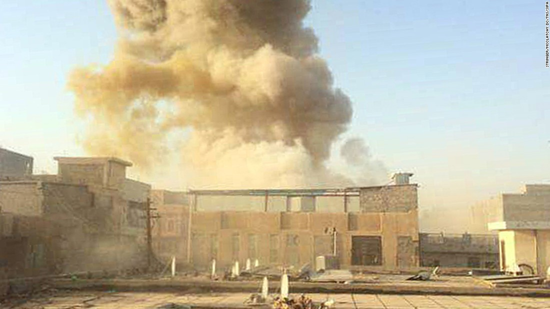 A car bomb, believed to be set by ISIS militants, explodes at the gate of a government building near the provincial governor's compound in Ramadi on Saturday, May 16.