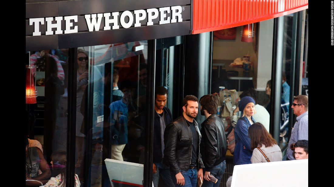 "Bradley Cooper wasn't just stopping by a London Burger King for a Whopper run in July 2014. He was actually doing work -- and in more ways than one. <a href=""http://www.eonline.com/news/564126/why-is-bradley-cooper-working-at-burger-king"" target=""_blank"">According to E! News</a>, the Oscar nominee got behind the grill and learned how to flip burgers for a role in an upcoming movie."