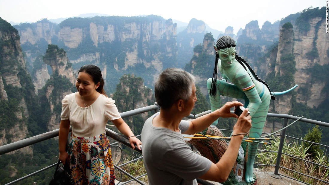 "An Avatar sculpture atop Tianzi Mountain. The location and it surroundings are said to have inspired James Cameron's film ""Avatar."""