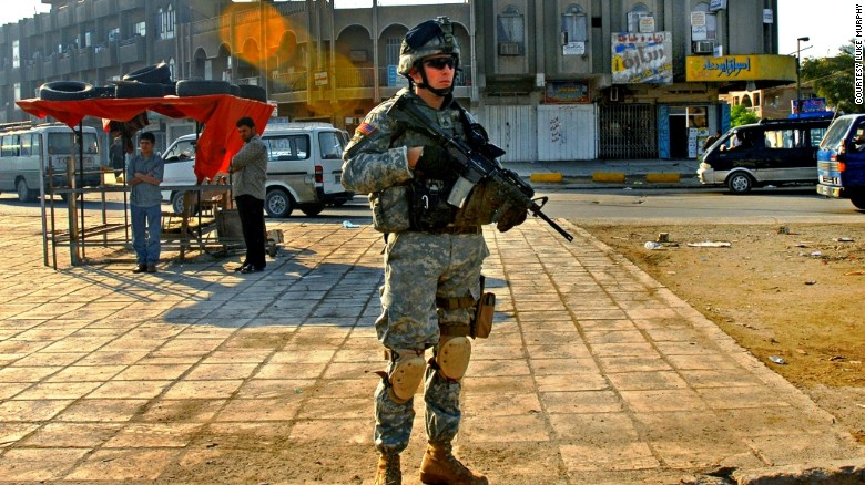 Murphy patrols in the Sadr City area of Baghdad, Iraq, in an undated photo.