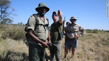 Corey Knowlton, center, hunts a black rhino in Namibia.