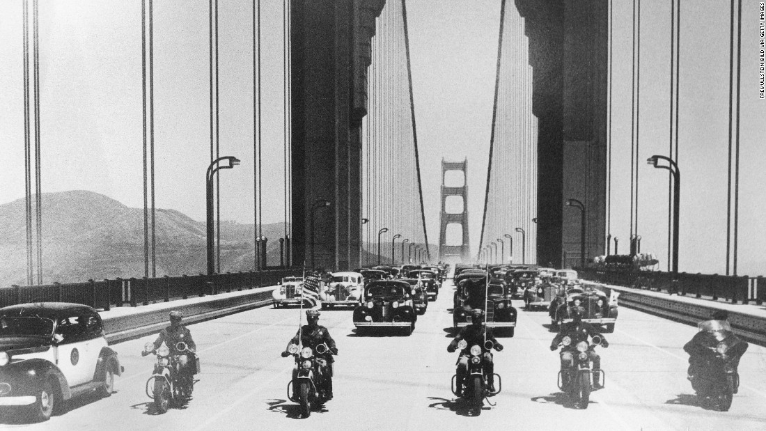 The first vehicles, led by a police escort, cross the bridge and head south into San Francisco on May 28, 1937. The structure was once the longest suspension bridge in the world, although it was surpassed in 1964 with the completion of the Verrazano-Narrows Bridge in New York.