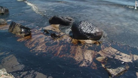 Burst pipeline cloaks California beaches with oil