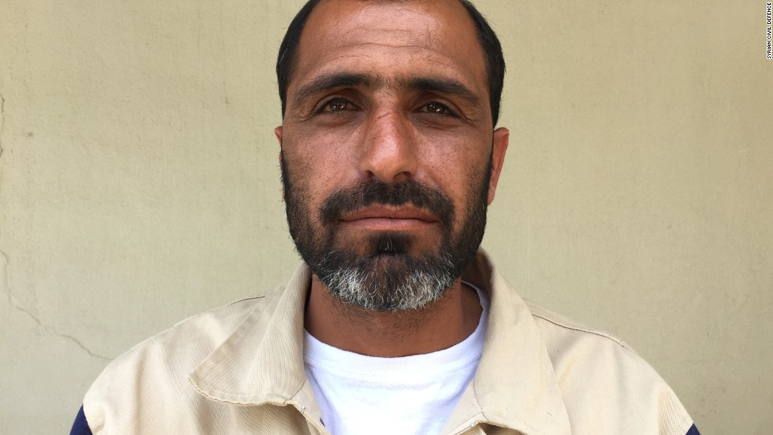 "Zuhair Armanazi, 39. Blacksmith. ""A teacher and three students were thrown out of their classroom, when the regime dropped a bomb on their school. I found a boy, about 11 years old, buried to the chest with rubble. I dug him out and saved him."""