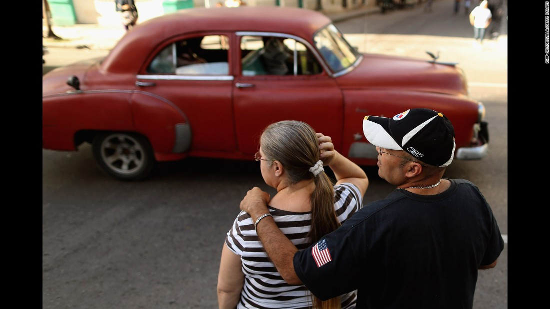 A man with the American flag on his sleeve stands with a woman in Havana in January.
