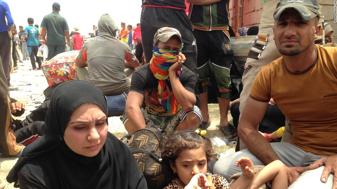 A family waits on the Bzebiz Bridge as they try to flee Iraq's Anbar province, where the militant group ISIS has made recent gains. The family has been displaced five times in the past year and half, failing to find safe areas away from ISIS.