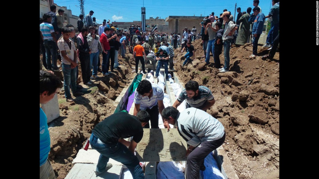 """People gather on May 26, 2012, at a mass burial for victims reportedly killed by Syrian forces in Syria's Houla region. U.N. officials confirmed that <a href=""""http://ift.tt/1j22vzB; target=""""_blank"""">more than 100 Syrian civilians were killed</a>, including nearly 50 children. Syria's government denied its troops were behind the bloodbath."""