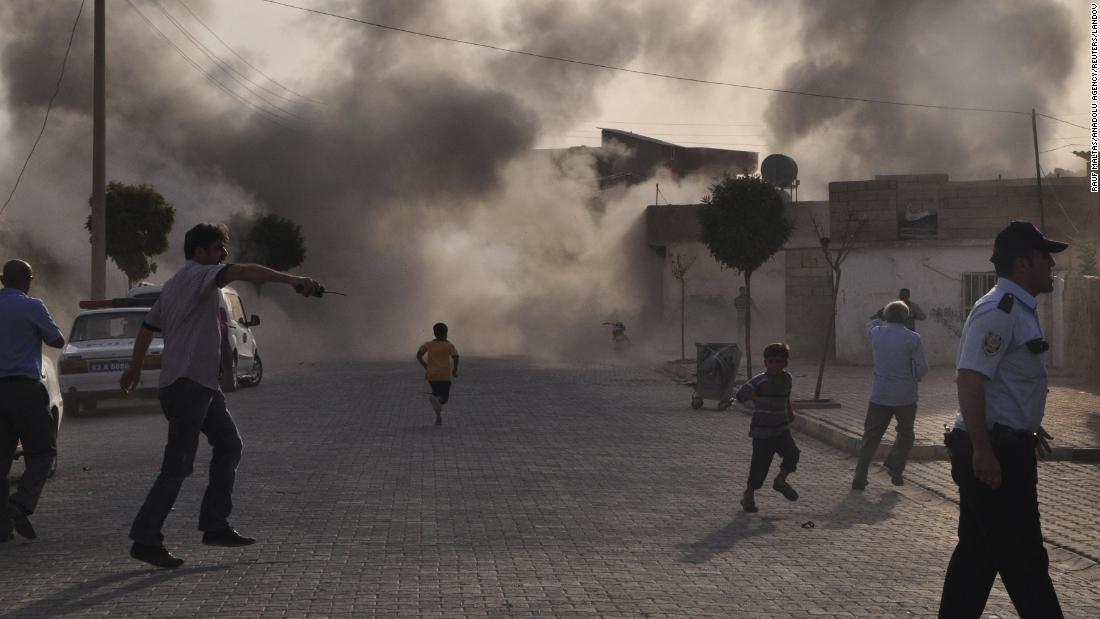 """Smoke rises over the streets after a mortar bomb from Syria landed in the Turkish border village of Akcakale on October 3, 2012. Five people were killed. In response, <a href=""""http://ift.tt/1j22w6O; target=""""_blank"""">Turkey fired on Syrian targets</a> and its parliament authorized a resolution giving the government permission to deploy soldiers to foreign countries."""