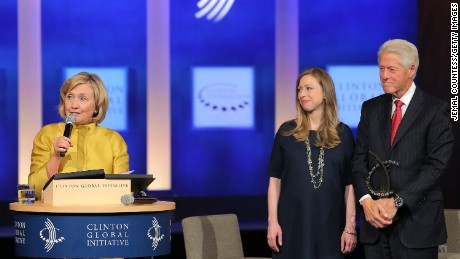 NEW YORK, NY - SEPTEMBER 24: (L-R) Former U.S. Secretary of State Hillary Clinton, vice-chair of the Clinton Global Initiative Chelsea Clinton and founder of the Clinton Global Initiative Bill Clinton onstage during the fourth day of the Clinton Global Initiative's 10th Annual Meeting at the Sheraton New York Hotel & Towers on September 24, 2014 in New York City. The annual meeting, established in 2005 by President Clinton, convenes global leaders to discuss solutions to world problems. (Photo by Jemal Countess/Getty Images)