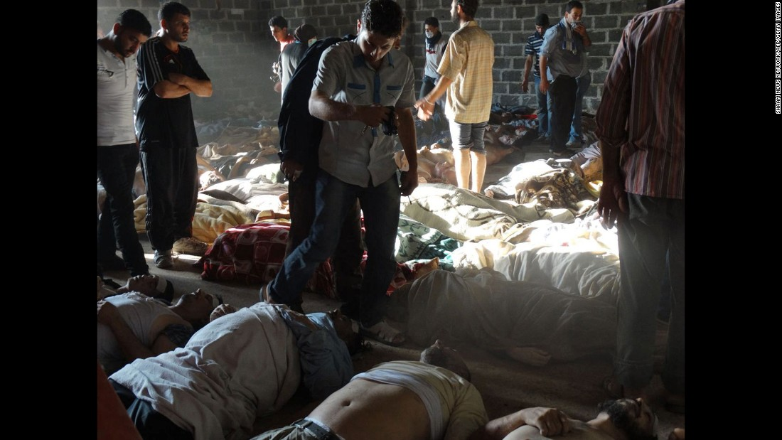 """A handout image released by the Syrian opposition's Shaam News Network shows people inspecting bodies of children and adults who rebels claim were killed in a toxic gas attack by pro-government forces on August 21, 2013. A week later, U.S Secretary of State John Kerry said U.S. intelligence information found that <a href=""""http://ift.tt/1WcUBla; target=""""_blank"""">1,429 people were killed</a> in the chemical weapons attack, including more than 400 children. Al-Assad's government claimed that jihadists fighting with the rebels carried out the chemical weapons attacks to turn global sentiments against it."""