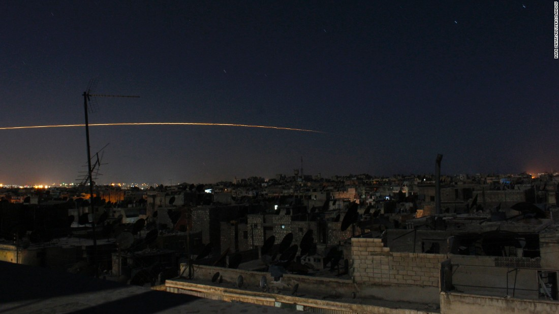 A long-exposure photograph shows a rocket being launched in Aleppo on October 5, 2014.