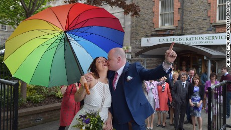 Newly married couple Anne and Vincent Fox kiss on Friday, May 22 to celebrate their wedding and to show their support for the Yes campaign in favour of same-sex marriage before casting their votes at a polling station in Dublin, Ireland. Ireland's voters are being asked to approve a change to the constitution to allow same-sex marriage