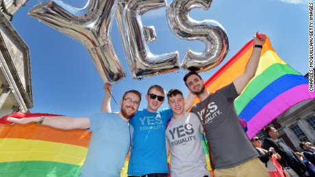 Supporters in favour of same-sex marriage pose for a photograph as thousands gather in Dublin Castle square awaiting the referendum vote outcome on May 23.