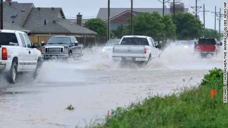 Motorists navigate deep water on after heavy rain showers flood much of the city, Saturday, May 23, 2015 in Amarillo, Texas. Amarillo received 1.7 inches of rain according the National Weather Service. (Michael Schumacher/The Amarillo Globe News via AP)