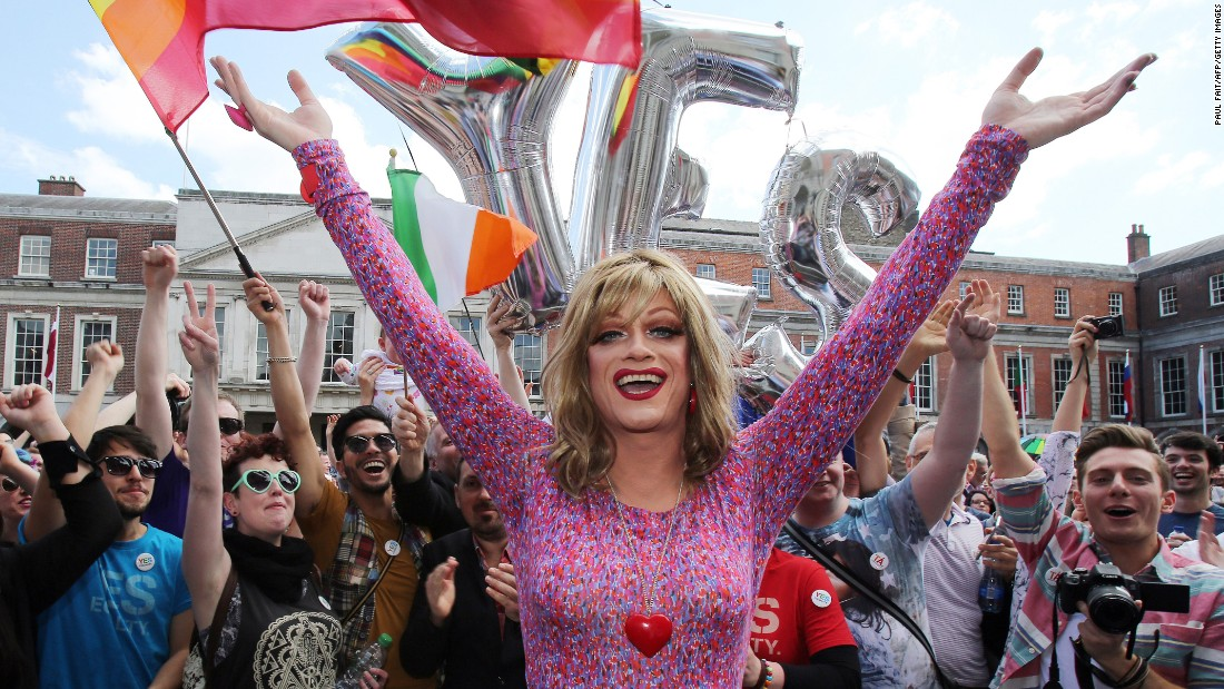 Drag queen and gay rights activist Rory O'Neill, also known by the stage name Panti, raises her arms with supporters for same-sex marriage at Dublin Castle on Saturday, May 23.