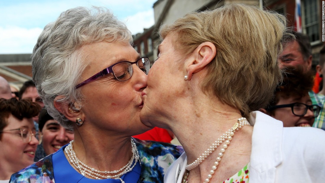 Sen. Katherine Zappone kisses Ann Louise Gilligan on Saturday, May 23, at the central count station at Dublin Castle, Dublin, after Zappone proposed live on televison. By a solid majority, Ireland became the first country in the world to legalize same-sex marriage by popular vote.