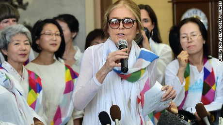US feminist Gloria Steinem (C) speaks to the media as her group of peace activists arrives at the inter-Korea transit office after they crossed the border line through the demilitarised zone (DMZ) separating the two Koreas in Paju on May 24, 2015. A group of women peace activists, led by Steinem, made a rare crossing of one of the world's most militarised borders on May 24 to promote reconciliation between North and South Korea. AFP PHOTO / JUNG YEON-JE (Photo credit should read JUNG YEON-JE/AFP/Getty Images)