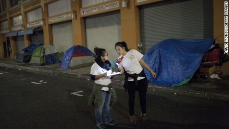 Caption:LOS ANGELES, CA - JANUARY 29: Volunteers count homeless people on a dark street on Skid Row during the 2015 Greater Los Angeles Homeless Count conducted by the Los Angeles Homeless Services Authority (LAHSA) on January 29, 2015 in Los Angeles, California. About 6,000 volunteers take part in counting the homeless people that they see as well as tents, cars and other structures used by the homeless, but avoid estimating the amount of people that might be inside such shelters. The last Greater Los Angeles Homeless Count, which took place in 2013, found that LA had one of the largest homeless populations in the country, with more than 39,000 men, women and children living on the streets. (Photo by David McNew/Getty Images)