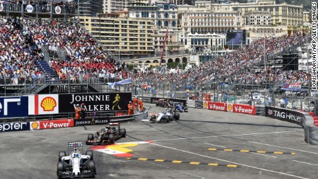 (From L) Williams Martini Racing's Brazilian driver Felipe Massa, Lotus F1 Team's French driver Romain Grosjean and Williams Martini Racing's Finnish driver Valtteri Bottas at the Monaco street circuit in Monte-Carlo on May 24, 2015, during the Monaco Formula One Grand Prix. AFP PHOTO / POOL / BORIS HORVAT (Photo credit should read BORIS HORVAT/AFP/Getty Images)
