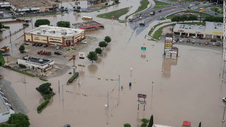 Record-setting rains and dangerous storms have been battering Texas and Oklahoma over the Memorial Day weekend. A shopping center was submerged in water from Blanco River flooding in San Marcos, Texas, on Sunday, May 24.