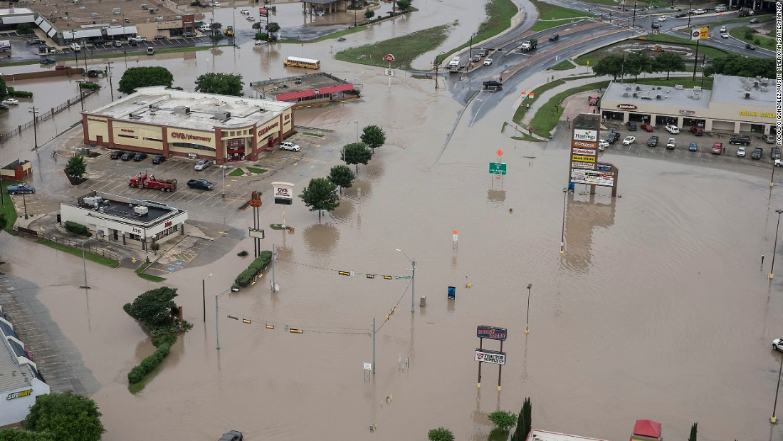 A shopping center is submerged in water in San Marcos on Sunday, May 24.