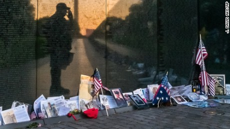 Army veteran Bernie Klemanek, of Mineral, Virginia, stops to salute his fallen comrades during an early morning visit to the Vietnam War Memorial in Washington on Monday, May 25.