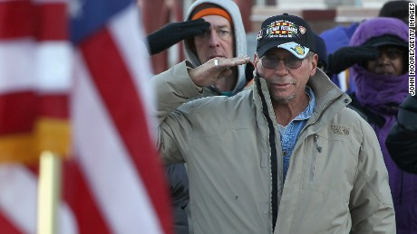 DENVER, CO - NOVEMBER 03: Homeless U.S. military veterans salute the flag during the Pledge of Allegiance at a 'Stand Down' event hosted by the Department of Veterans Affairs on November 3, 2011 in Denver, Colorado. A week ahead of Veterans Day, more than 500 homeless veterans were expected to attend the event, where they received free clothing, medical care, employment assistance and were able to see a judge to resolve legal issues. Organizers say the homeless veterans population has surged in recent years with the high national unemployment rate. Stand Down is a military term that means a temporary stop of offensive military action. (Photo by John Moore/Getty Images)
