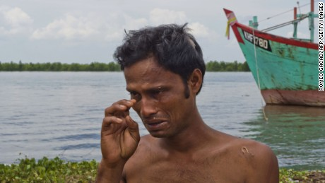 In this photograph taken on May 18, 2015, rescued Bangladeshi migrant Mohammad Murad Hussein, with scars on his head and body, breaks down at Langsa port in Aceh as he narrates the incident when he was attacked and badly beaten by Rohingya migrants from Myanmar over a desperate fight for food aboard the boat before they were rescued by Indonesian fishermen. Bangladeshi survivors claim about 200 Bangladeshis were killed and were thrown overboard as violence broke out with Rohingya migrants from Myanmar. AFP PHOTO / ROMEO GACAD (Photo credit should read ROMEO GACAD/AFP/Getty Images)