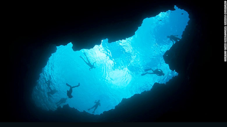 "Snorkelers love hovering above a ""blue hole"" in a Palau reef."