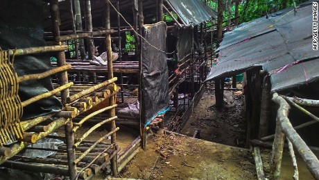 "This undated handout photo made available on May 25, 2015 by the Royal Malaysian Police shows an abandoned migrant detention camp used by people-smugglers in a jungle near the Malaysia-Thailand border in Genting Perah. Malaysian police said May 25 they had found 139 grave sites and 28 abandoned detention camps used by people-smugglers and capable of housing hundreds, laying bare the grim extent of the region's migrant crisis. AFP PHOTO / ROYAL MALAYSIAN POLICE --- EDITORS NOTE --- RESTRICTED TO EDITORIAL USE -- MANDATORY CREDIT ""AFP PHOTO / ROYAL MALAYSIAN POLICE"" NO MARKETING - NO ADVERTISING CAMPAIGNS -- DISTRIBUTED AS A SERVICE TO CLIENTSROYAL MALAYSIAN POLICE/AFP/Getty Images"
