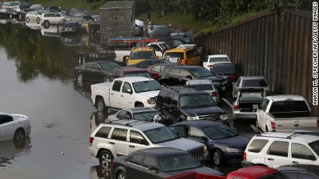 Vehicles left stranded on a flooded Interstate 45 in Houston, Texas on May 26, 2015.  Heavy rains throught Texas put the city of Houston under massive ammounts of water, closing roadways and trapping residents in their cars and buildings, according to local reports. Rainfall reached up to 11 inches(27.9cm) in some parts of the state, national forecasters reported, and the heavy rains quickly pooled over the state's already saturated soil. AFP PHOTO/AARON M. SPRECHER        (Photo credit should read Aaron M. Sprecher/AFP/Getty Images)