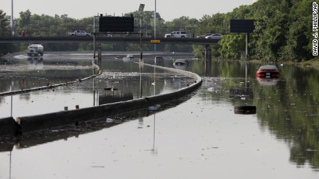 Cars remain stranded along a flooded section of Interstate 45 after heavy rains overnight in Houston, Tuesday, May 26, 2015. Several major highways are closed in the Houston area due to high water. (AP Photo/David J. Phillip/AP)