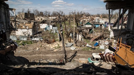 A picture taken on April 23, 2015 shows residential houses destroyed after shelling in the village of Peski, near Donetsk, on April 23, 2015. The chief OSCE monitor in eastern Ukraine said on April 23 there was little point increasing the size of its mission while its access to conflict areas remains restricted, saying the situation remains 'fragile'.