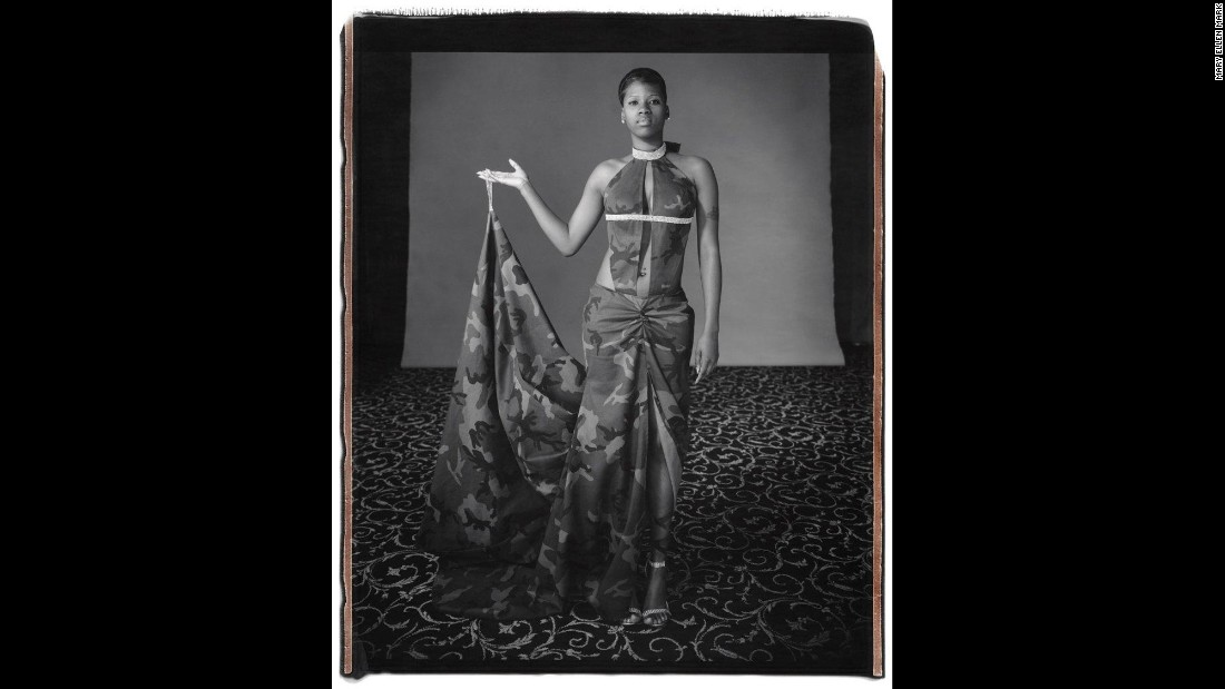 "Taneya Hammer poses on prom night in Newark, New Jersey, in 2006. The photo is part of <a href=""http://www.maryellenmark.com/books/titles/prom/index002_prom.html"" target=""_blank"">Mary Ellen Mark's ""Prom"" series</a>, which became <a href=""http://shop.getty.edu/products/prom-978-1606061084"" target=""_blank"">a book in 2012</a>. Beyond projecting personal style, prom photos reflect socioeconomic and cultural values from an American rite of passage, the legendary documentary photographer <a href=""http://www.cnn.com/2012/04/19/living/ireport-prom-photos/"" target=""_blank"">told CNN in 2012</a>. <a href=""http://money.cnn.com/2015/05/26/news/mary-ellen-mark/"" target=""_blank"">Mark died Monday, May 25,</a> at the age of 75."