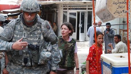 Political adviser Emma Sky walks through a Baghdad market with General Ray Odierno.