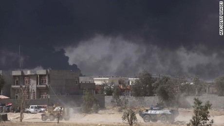 Iraqi pro-government forces, including fighters from the Shiite Muslim Al-Abbas popular mobilisation unit, take part in an operation to retake the Baiji oil refinery from Islamic State (IS) group jihadists, on April 15, 2015. The refinery -- some 200 kilometres (120 miles) north of Baghdad -- once produced some 300,000 barrels of refined products per day, meeting half the country's needs. AFP PHOTO / MOHAMMED SAWAFMOHAMMED SAWAF/AFP/Getty Images