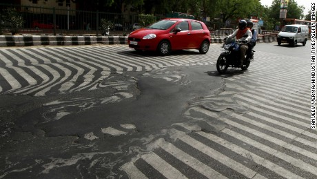 A road melts near Safdarjung Hospital in Delhi on May 24.