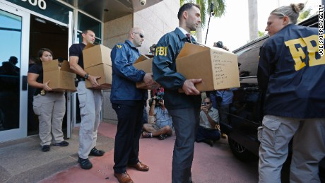 MIAMI BEACH, FL - MAY 27: FBI agents carry boxes from the headquarters of CONCACAF after it was raided on May 27, 2015 in Miami Beach, Florida. The raid is part of an international investigation of FIFA where nine FIFA officials and five corporate executives were charged with racketeering, wire fraud and money laundering conspiracies. (Photo by Joe Skipper/Getty Images)