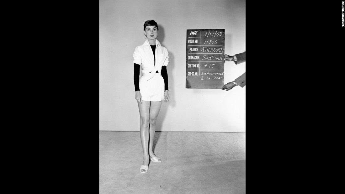 "Hepburn stands for a wardrobe test shot for the film ""Sabrina,"" which was released in 1954. Costume designer Edith Head won an Academy Award for the film, and it is hailed as the start of a longtime collaboration between Hepburn and designer Hubert de Givenchy."
