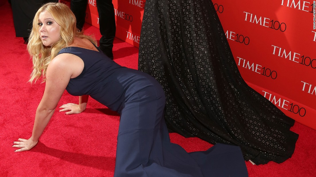 "Comedian Amy Schumer prostrates herself in front of Kim Kardashian and Kanye West at the 2015 Time 100 Gala. Schumer, known for her smart, raunchy, no-holds-barred comedy, is one of comedy's brightest rising stars. She is the lead in the popular Comedy Central series ""Inside Amy Schumer"" and had a hit movie with ""Trainwreck."""
