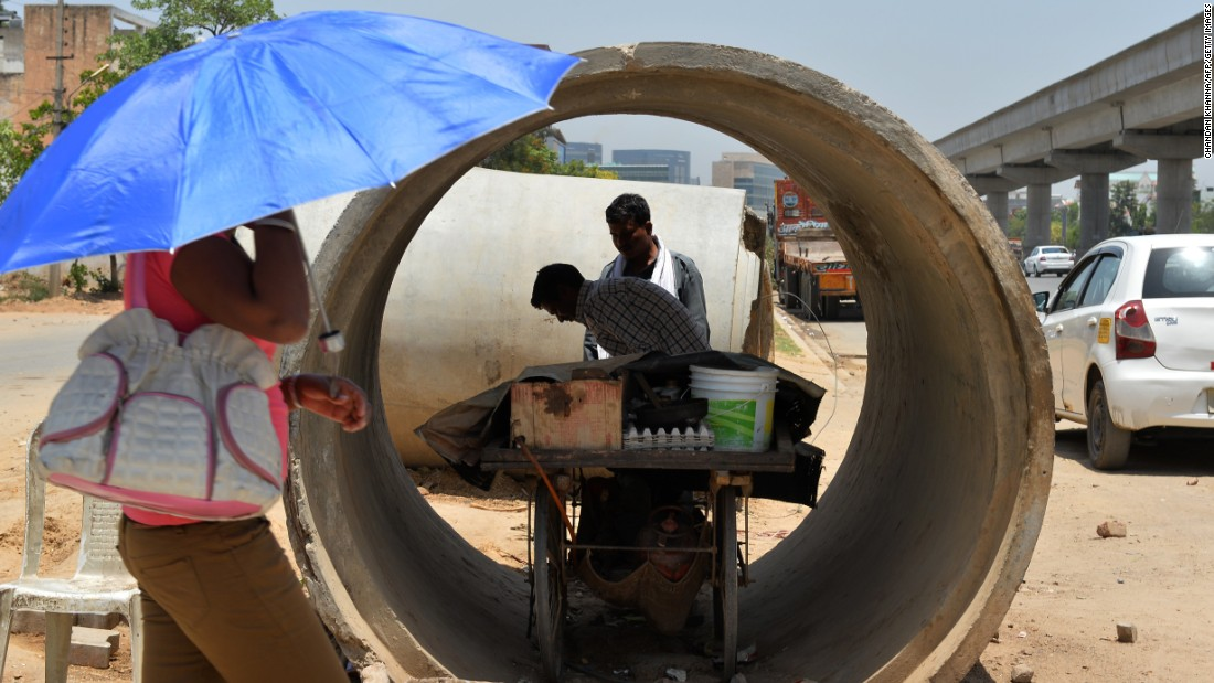 A roadside food vendor sets up his cart inside a concrete pipe in Gurgaon, on the outskirts of New Delhi, on May 27.
