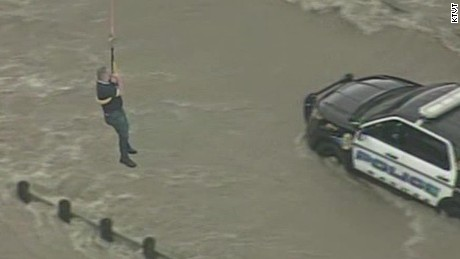 Officer plucked from floodwaters by helicopter