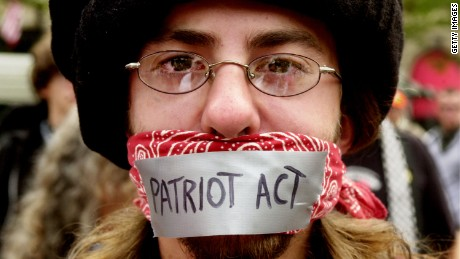 A man protests the Patriot Act during an anarchist rally on the final day of the Democratic National Convention at Copley Plaza July 29, 2004 in Boston, Massachusetts.